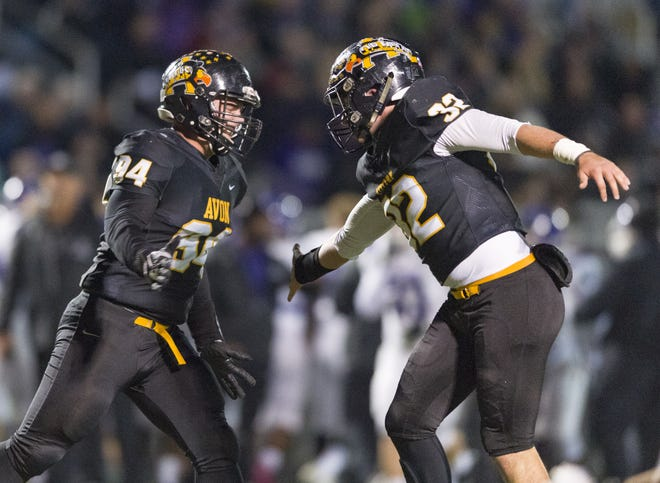 After stopping the Brownsburg High School offense, Avon High School seniosr Matt Bromm (94) and Alex Griffith (32) react to the turnover on downs during the first half of action. Avon High School hosted Brownsburg High School in an IHSAA varsity football Class 6A Sectional Championship game, Friday, Nov. 2, 2018.