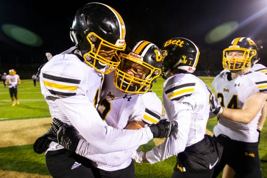 Bettendorf's Darien Porter (left) embraces Austin Kalar after a Class 4A quarter final football game on Friday, Nov. 2, 2018, at Trojan Field in Iowa City.