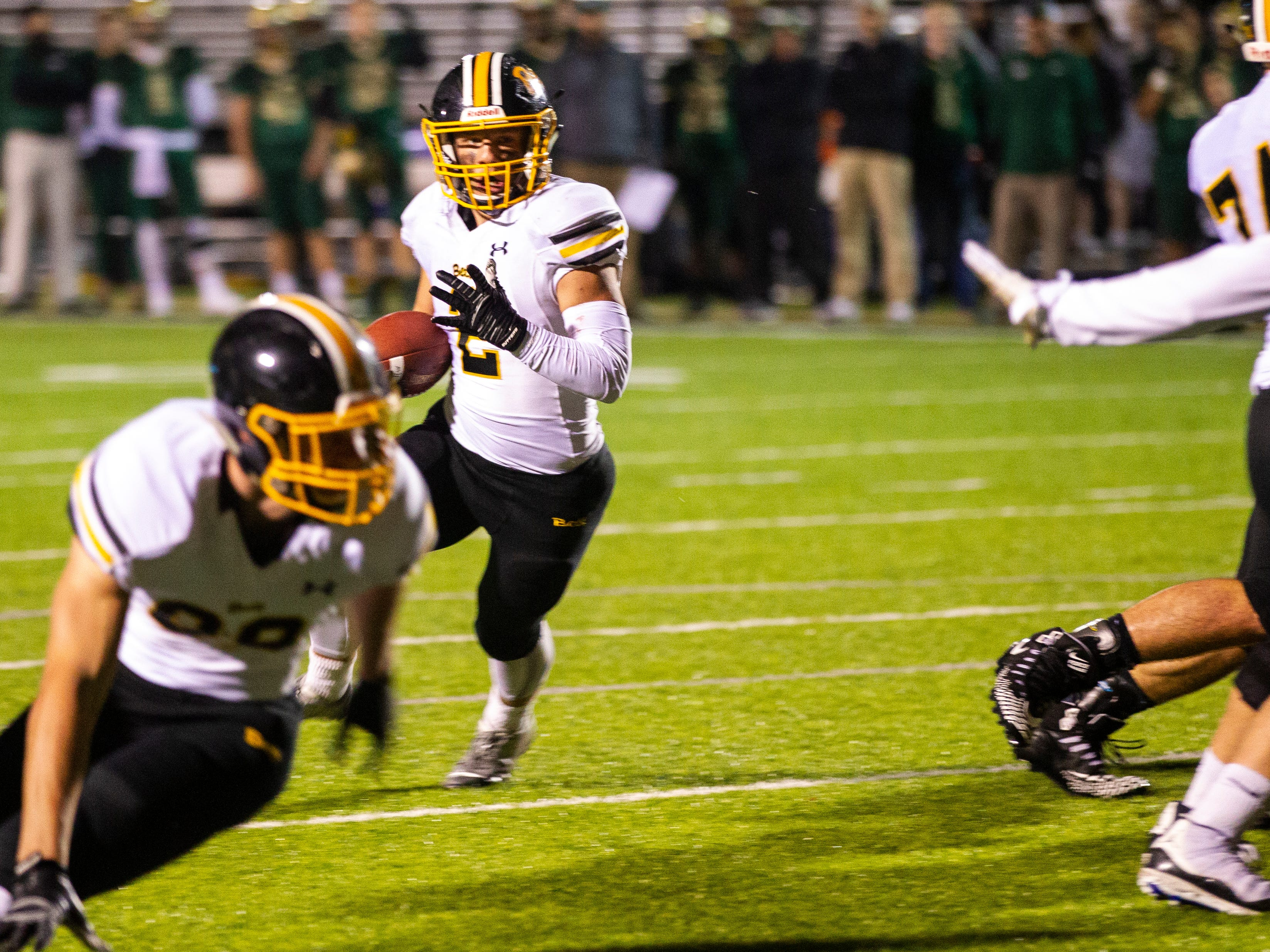 Bettendorf's Austin Kalar (2) rushes during a Class 4A quarter final football game on Friday, Nov. 2, 2018, at Trojan Field in Iowa City.