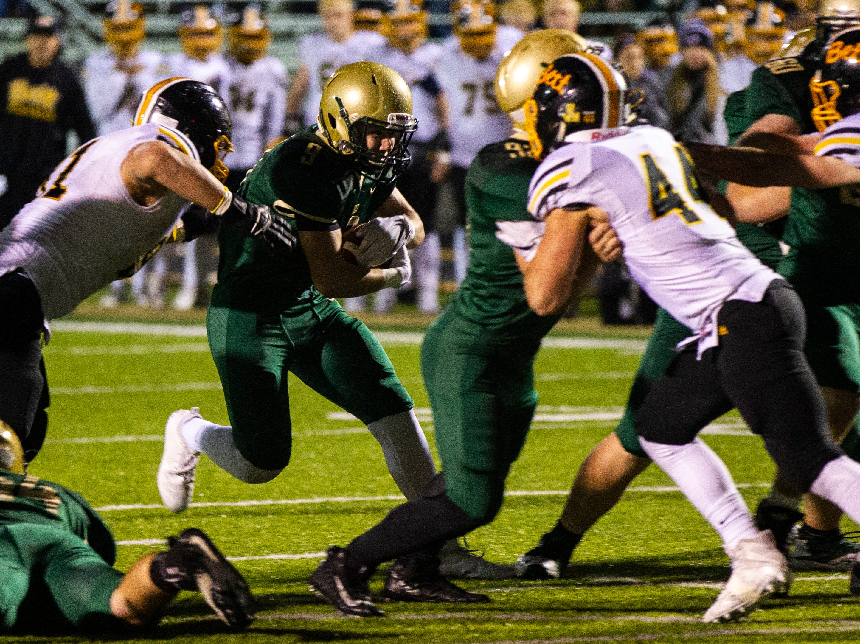 Iowa City West's Peter Breitbach (9) rushes during a Class 4A quarter final football game on Friday, Nov. 2, 2018, at Trojan Field in Iowa City.