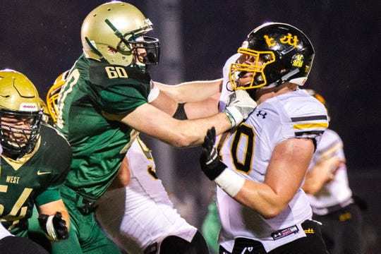 Bettendorf defensive lineman Griffin Liddle (70) blocks Iowa City West's Marshall Blatz (60) during a Class 4A quarter final football game on Friday, Nov. 2, 2018, at Trojan Field in Iowa City.