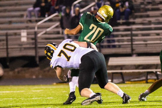 Bettendorf's Griffin Liddle (70) sacks Iowa City West's 	Marcus Morgan (20) during a Class 4A quarter final football game on Friday, Nov. 2, 2018, at Trojan Field in Iowa City.