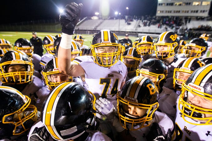 Bettendorf's Nile Ridenour (74) celebrates with teammates after a Class 4A quarter final football game on Friday, Nov. 2, 2018, at Trojan Field in Iowa City.