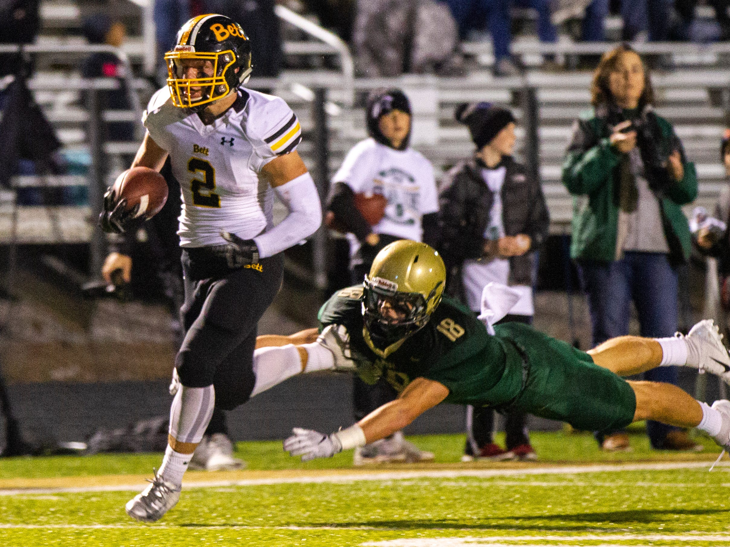 Bettendorf's Austin Kalar (2) gets tackled by Iowa City West's Cole Mabry (18) during a Class 4A quarterfinal football game on Friday, Nov. 2, 2018, at Trojan Field in Iowa City.