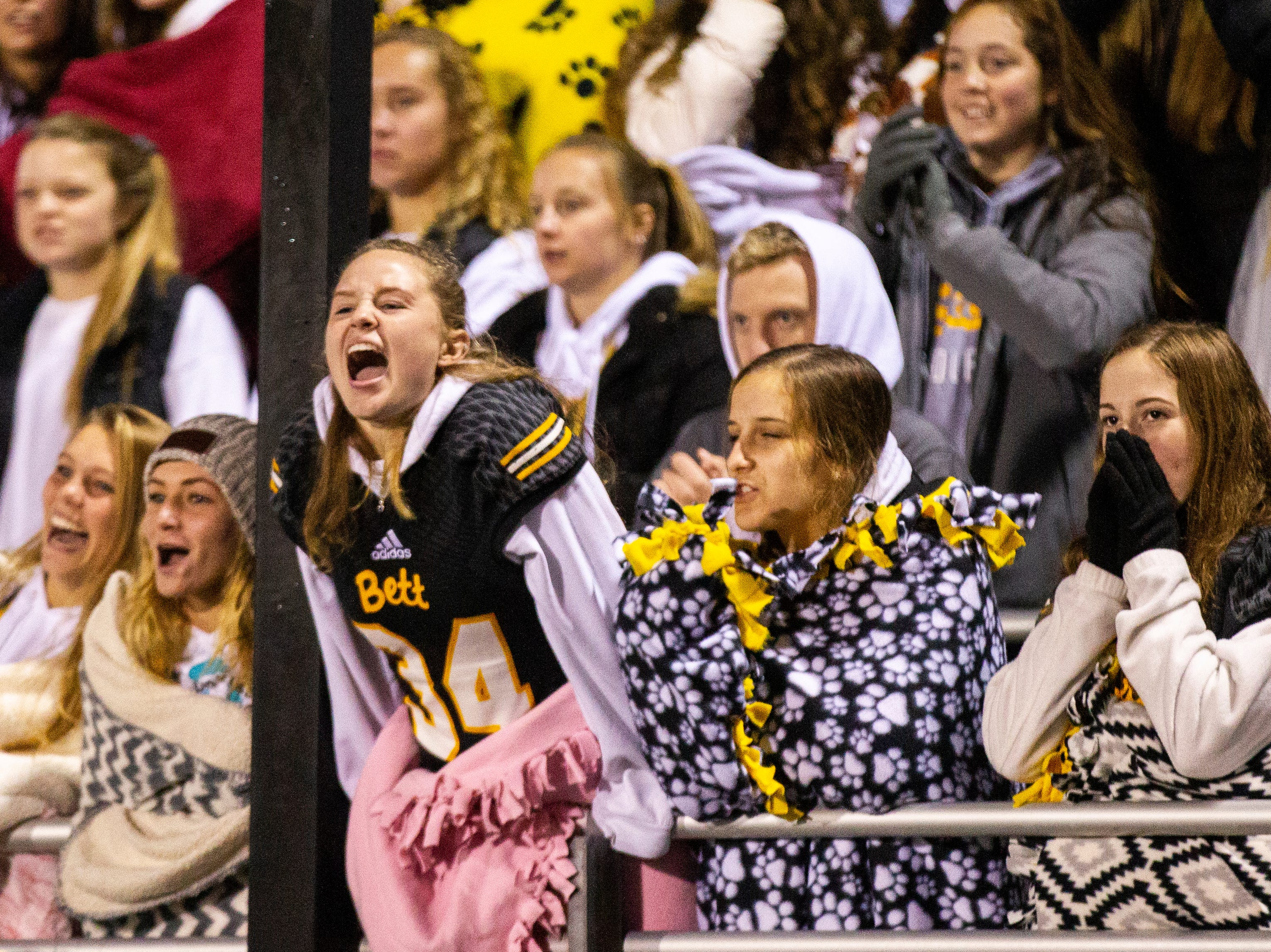 Bettendorf fans cheer during a Class 4A quarter final football game on Friday, Nov. 2, 2018, at Trojan Field in Iowa City.