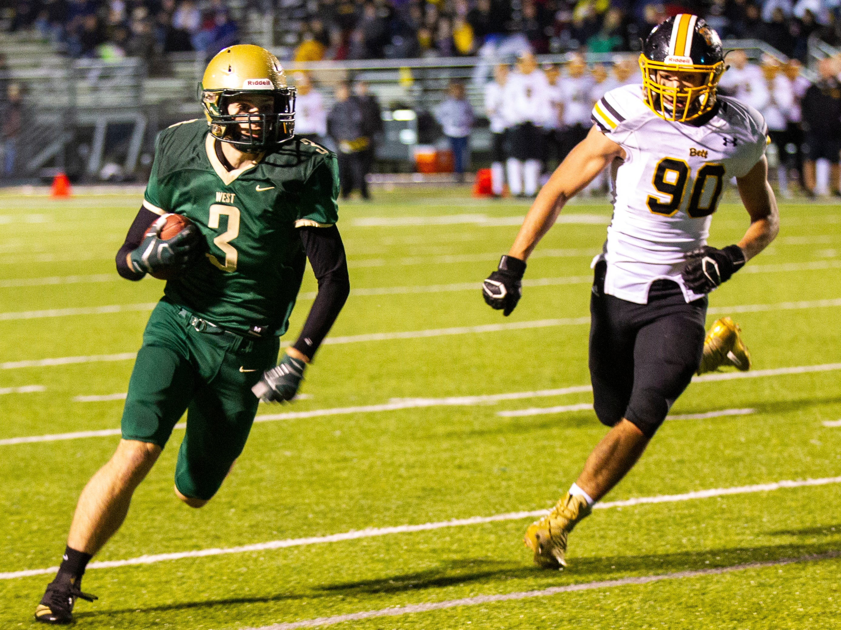 Iowa City West's Justin Thomas (3) runs for the goal line during a two point conversion during a Class 4A quarter final football game on Friday, Nov. 2, 2018, at Trojan Field in Iowa City.