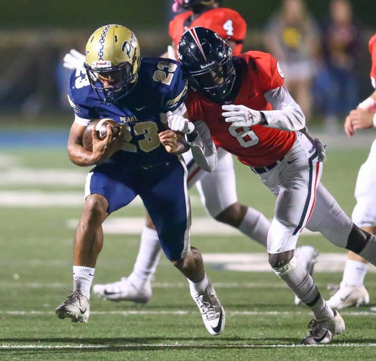 Brandon High School's Celeycan Hill (8) brings down Pearl High School's Kenyatta Harrell (23) following a big gain in the first half. Pearl played Brandon High School in an MHSAA Class 6A football game on Friday, November 2, 2018 at Pearl. Photo by Keith Warren