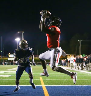 Brandon High School's Jonathan Mingo (18)  catches a touchdown pass to tie the game at 7-7. Pearl played Brandon High School in an MHSAA Class 6A football game on Friday, November 2, 2018 at Pearl. Photo by Keith Warren