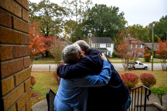 Pastor Pat Parham embraces Jean Ralston, both lifelong residents of Jackson with friends in the Jewish community, after the two drop off offerings at the doorsteps of the Congregation B'nai Israel in Jackson, Tenn., on Friday, Nov. 2, 2018.