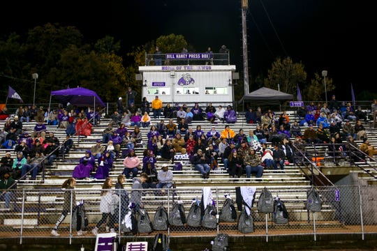 Milan fans brace the weather and crowd the stands in a TSSAA playoff game between Milan High School and Trezevant at Johnnie Hale Stadium in Milan, Tenn., on Friday, Nov. 2, 2018.