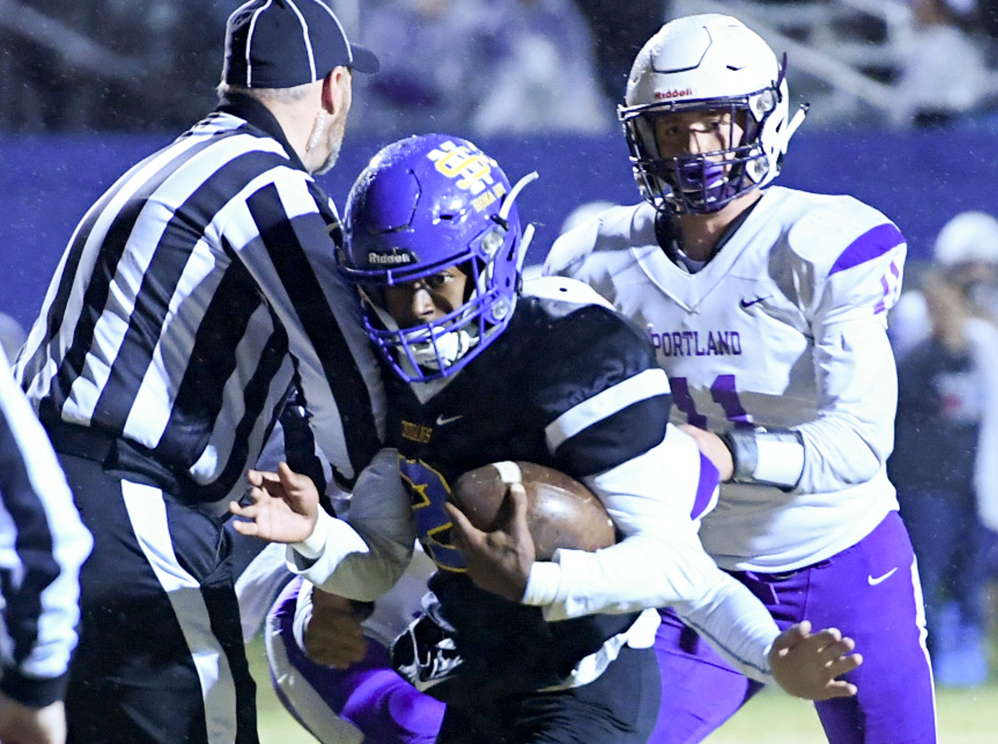 North Side's Kameron Farrington uses the referee for a screen to run in for a touchdown during their game against Portland, Friday, November 2. North Side defeated Portland, 50-6.