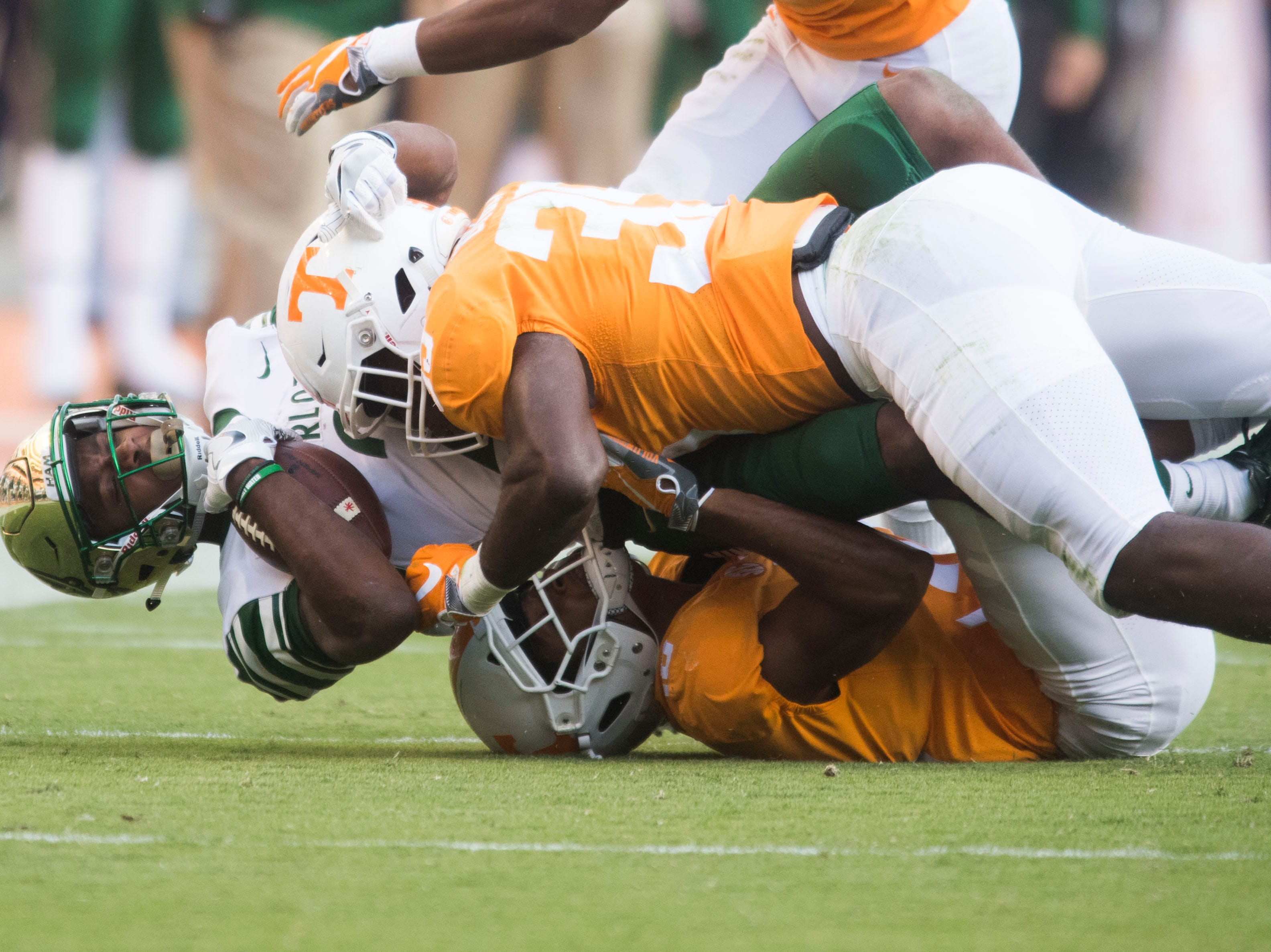 Charlotte wide receiver Rico Arnold (21) is taken down by Tennessee players during the homecoming game between Tennessee and Charlotte outside of Neyland Stadium Saturday, Nov. 3, 2018.