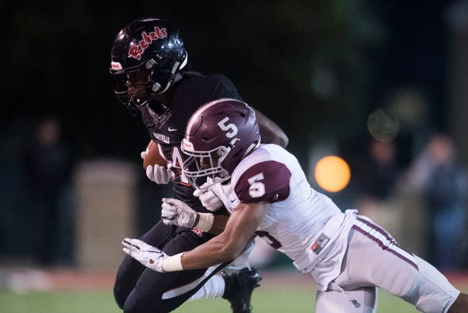 Maryville's Tee Hodge (44) is tackled by Bearden's Kahlil Abdullah (5) during a first round playoff game between Maryville and Bearden at Maryville, Friday, Nov. 2, 2018. Maryville defeated Bearden 28-7.