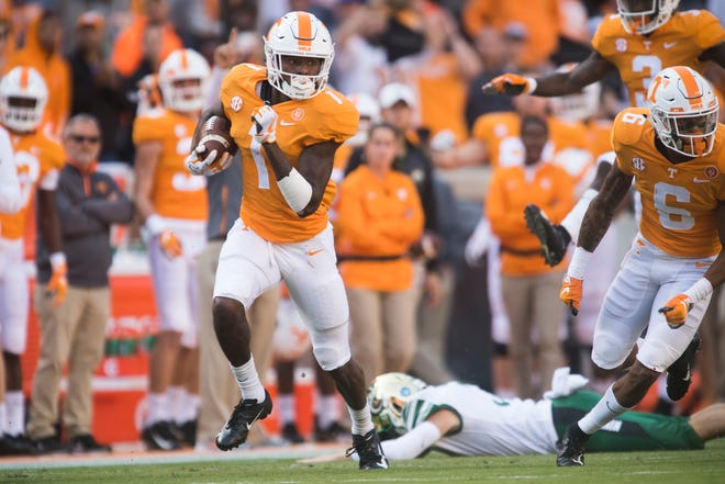 Tennessee wide receiver Marquez Callaway (1) runs up the field after escaping a tackle during the homecoming game between Tennessee and Charlotte outside of Neyland Stadium Saturday, Nov. 3, 2018.