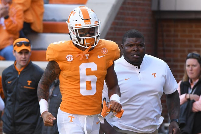 Tennessee's Alontae Taylor (6) runs off the field after being ejected from Saturday's game for targeting.