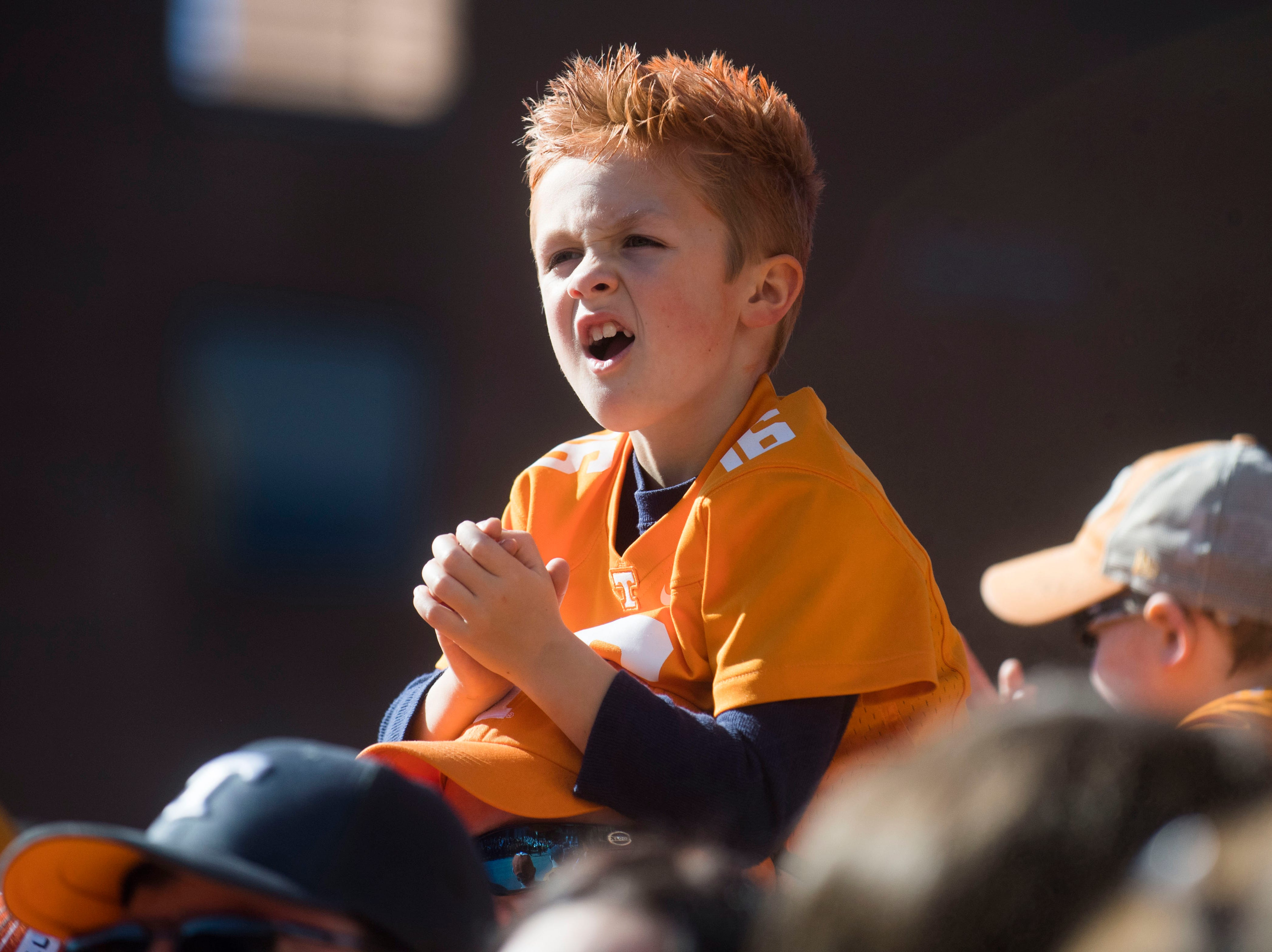 A young Tennessee fan waits for the Vol Walk before the homecoming game between Tennessee and Charlotte outside of Neyland Stadium Saturday, Nov. 3, 2018.