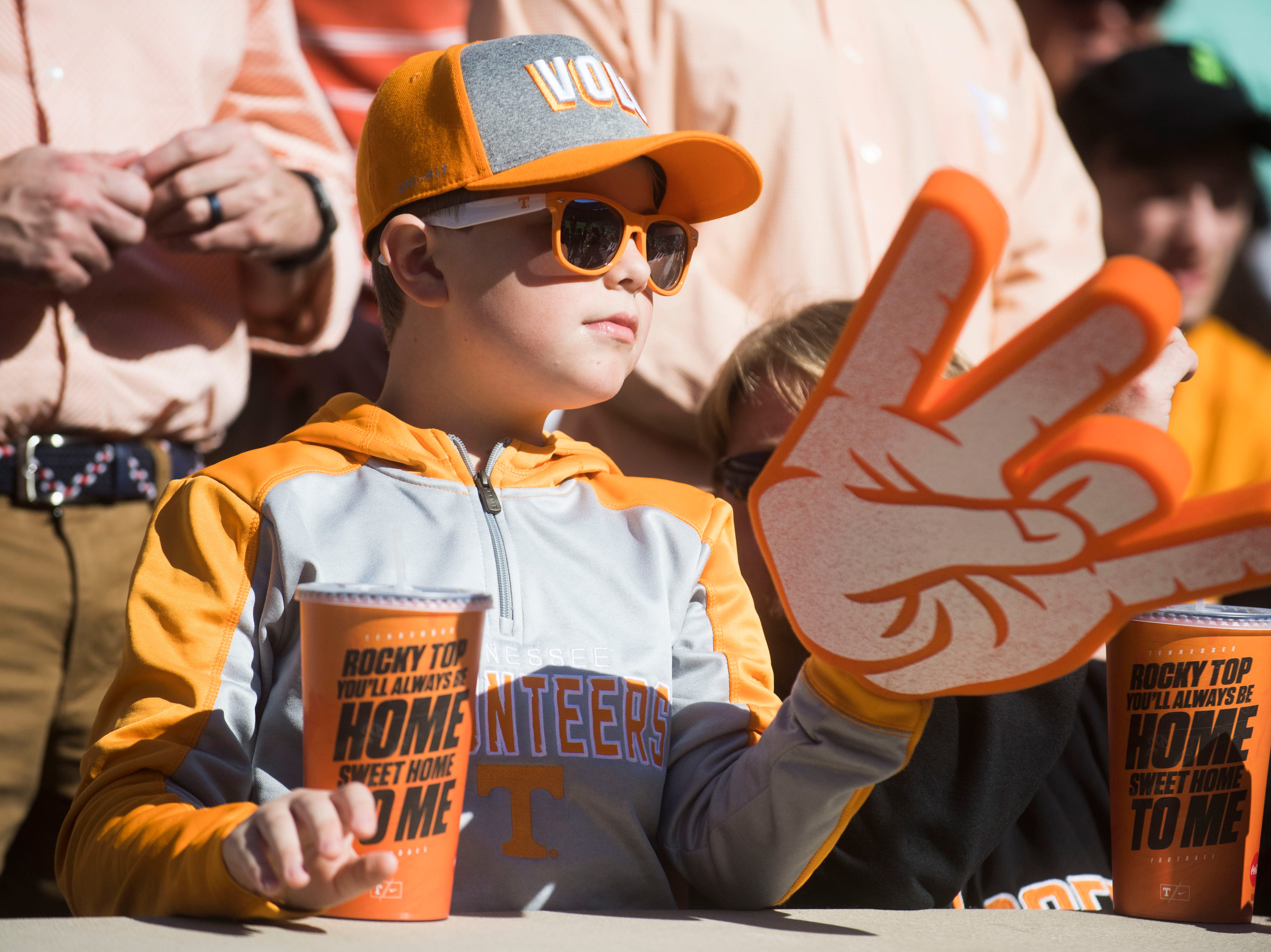A young Tennessee fan waits before the homecoming game between Tennessee and Charlotte outside of Neyland Stadium Saturday, Nov. 3, 2018.