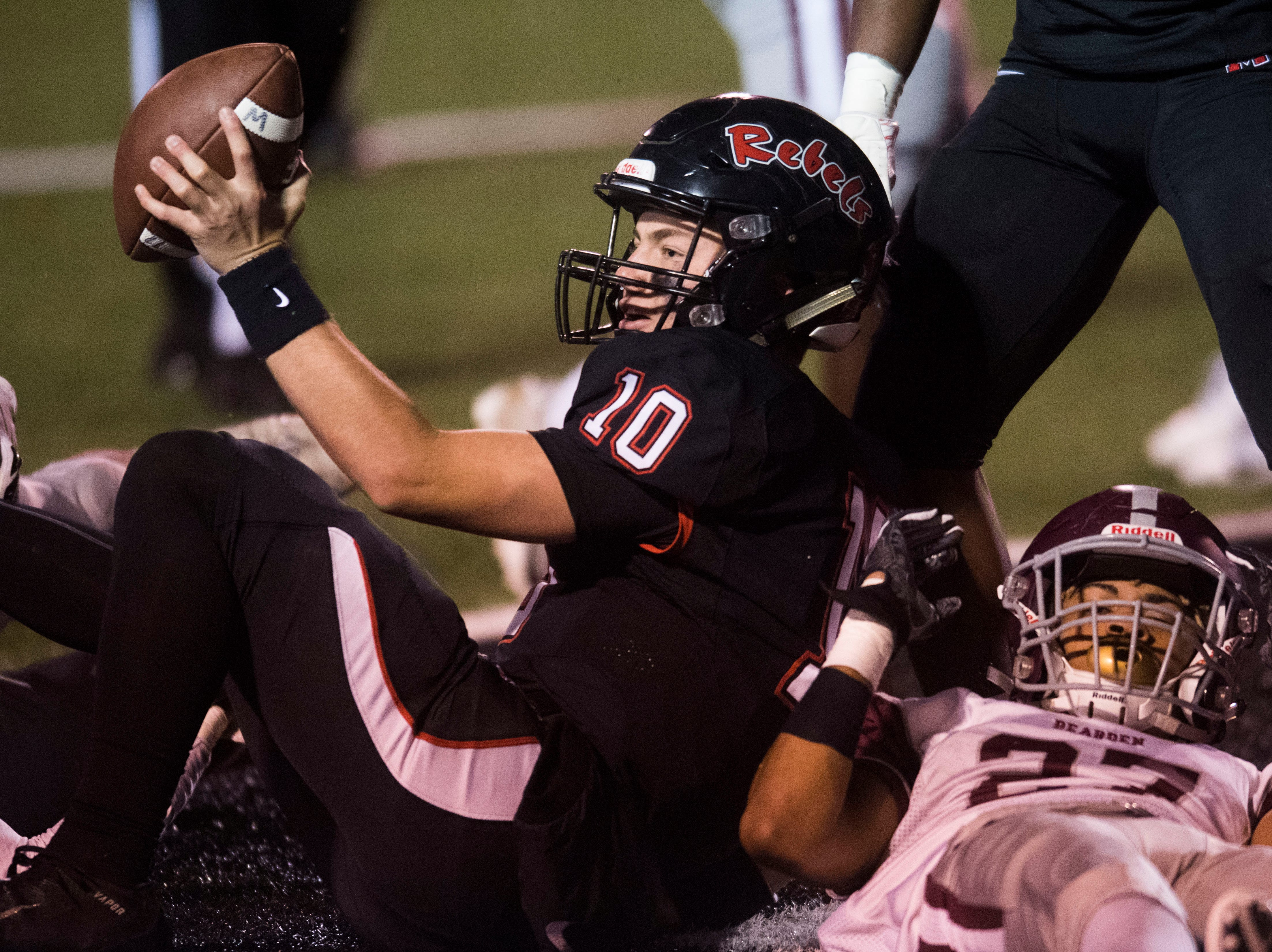 Maryville's Braden Carnes (10) holds the ball up after making a touchdown during a first round playoff game between Maryville and Bearden at Maryville, Friday, Nov. 2, 2018. Maryville defeated Bearden 28-7.