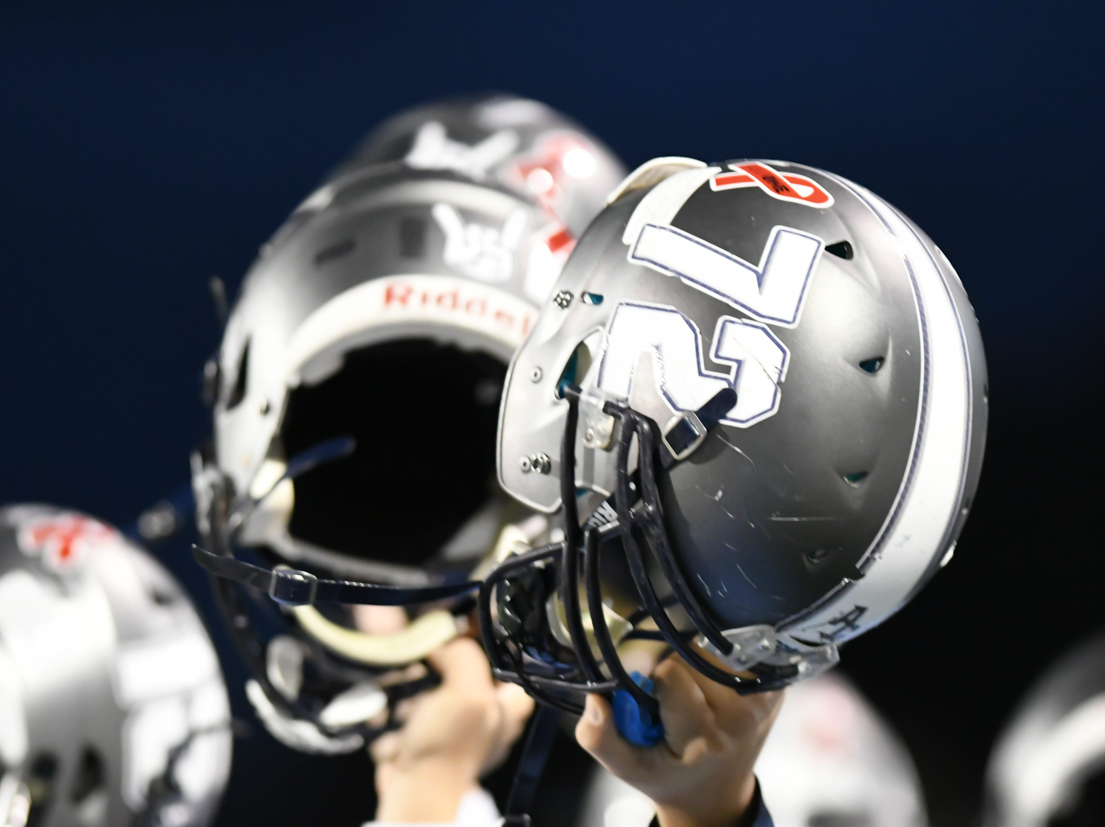 The Anderson County Mavericks raise their helmets before the football game against Union County at Anderson County on Friday, Nov. 2nd, 2018.