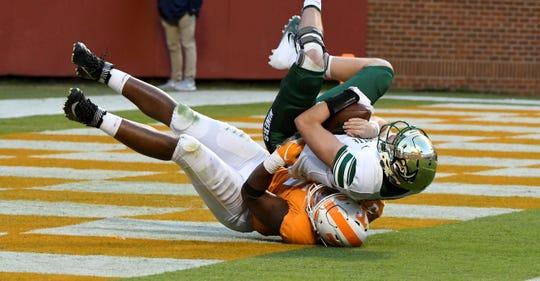 Tennessee defensive lineman Kyle Phillips (5) sacks Charlotte quarterback Evan Shirreffs (16) during first half action Saturday, November 3, 2018 at Neyland Stadium in Knoxville, Tenn.