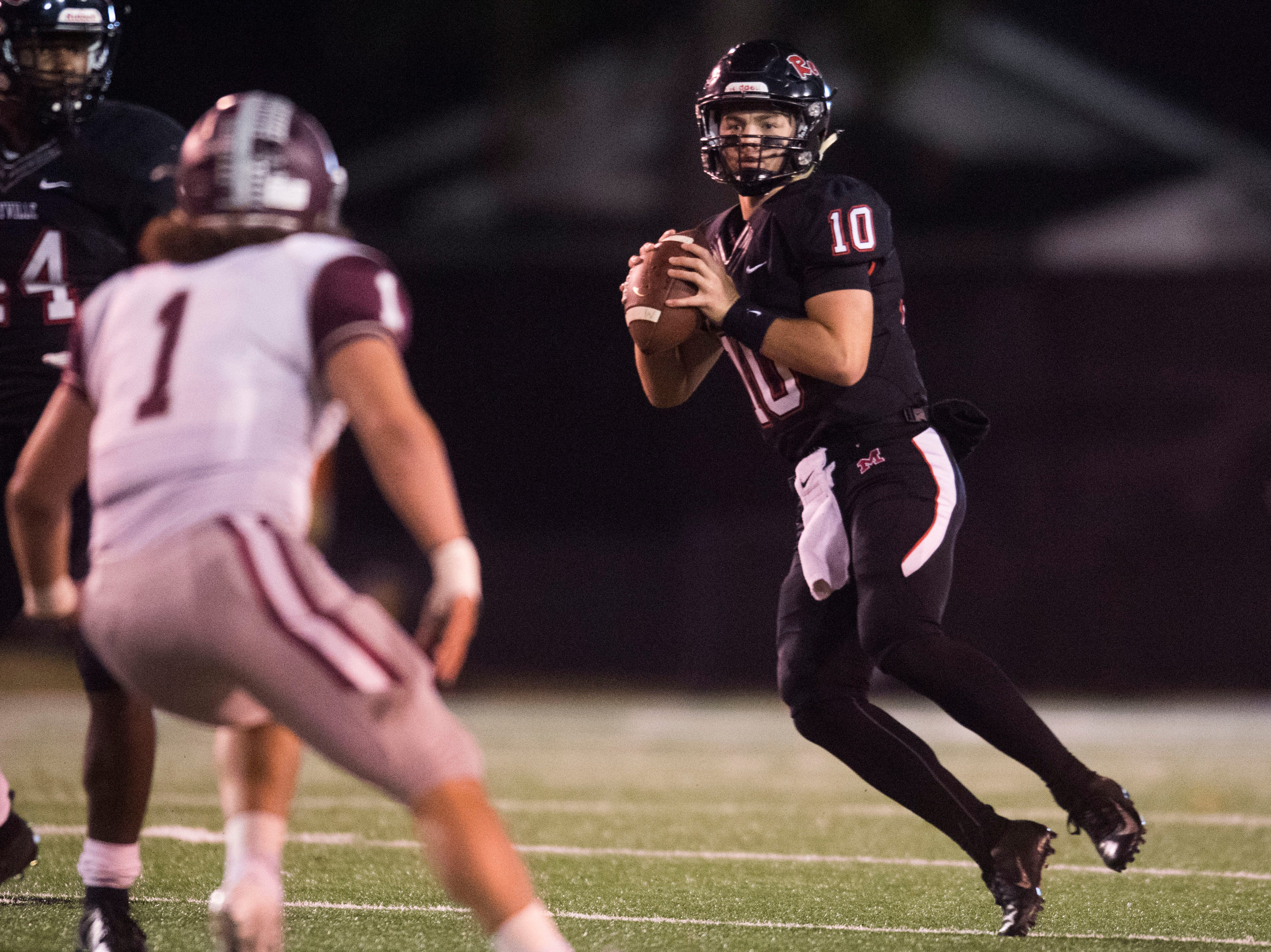 Maryville's Braden Carnes (10) prepares to pass the ball during a first round playoff game between Maryville and Bearden at Maryville, Friday, Nov. 2, 2018. Maryville defeated Bearden 28-7.