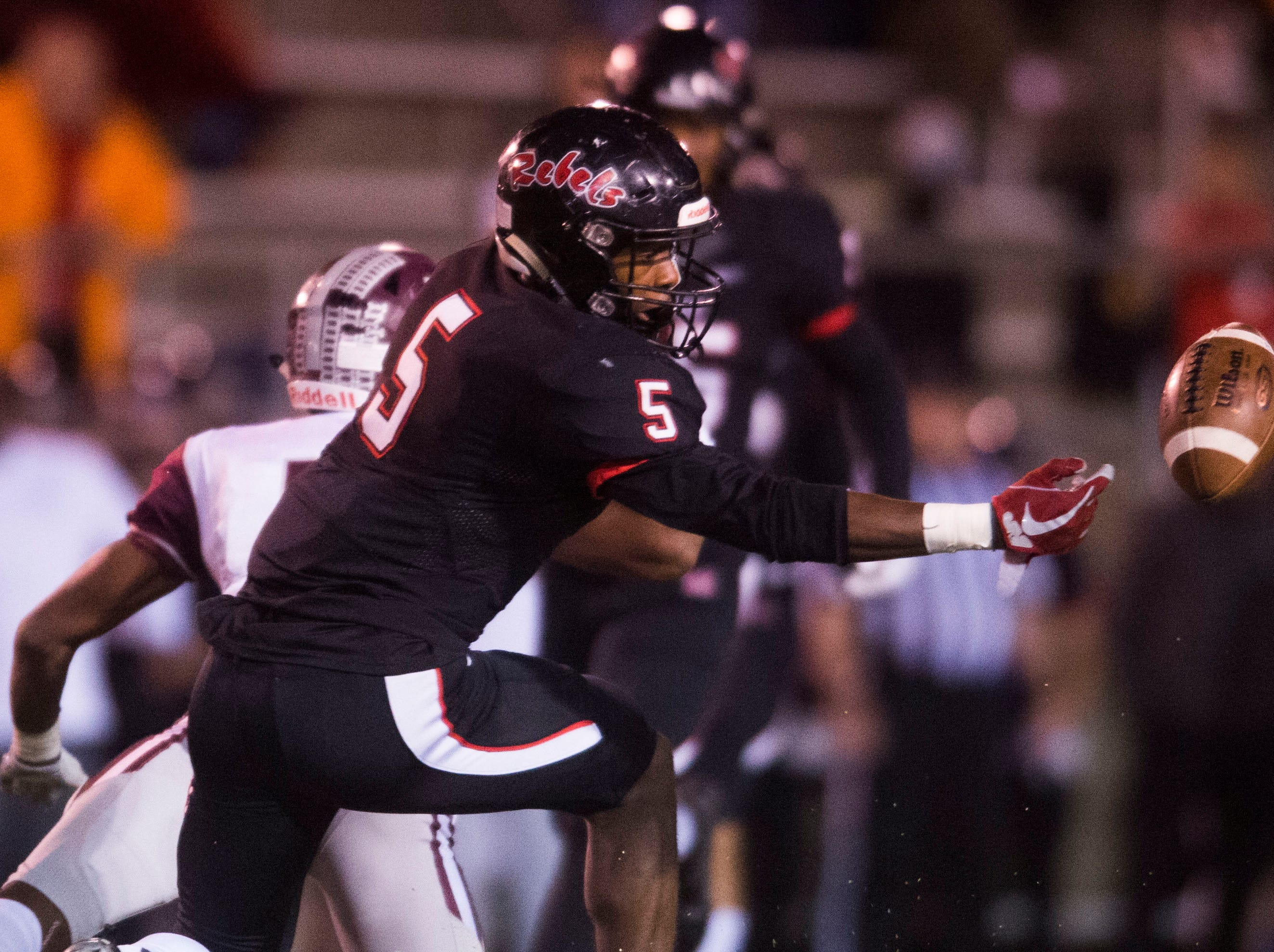 Maryville's DaVon Kimble (5) attempts to recover a fumbled ball during a first round playoff game between Maryville and Bearden at Maryville, Friday, Nov. 2, 2018. Maryville defeated Bearden 28-7.