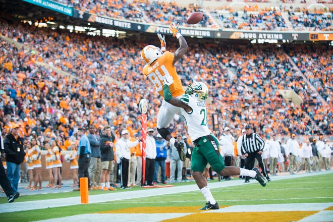 Tennessee wide receiver Josh Palmer (84) makes a catch in the end zone for a touchdown as Charlotte defensive back DJ Anderson (20) tries to defend during Tennessee's homecoming game against Charlotte at Neyland Stadium in Knoxville, Tennessee on Saturday, November 3, 2018.