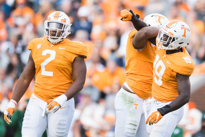 Tennessee defensive lineman Shy Tuttle (2), Tennessee linebacker Darrell Taylor (19) and another player celebrate during Tennessee's homecoming game against Charlotte at Neyland Stadium in Knoxville, Tennessee on Saturday, November 3, 2018.