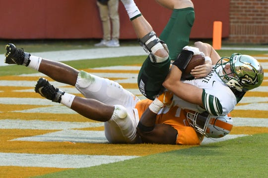 Tennessee defensive lineman Kyle Phillips (5) takes down a Charlotte player in the end zone  which was ruled not a safety during the homecoming game between Tennessee and Charlotte outside of Neyland Stadium Saturday, Nov. 3, 2018.