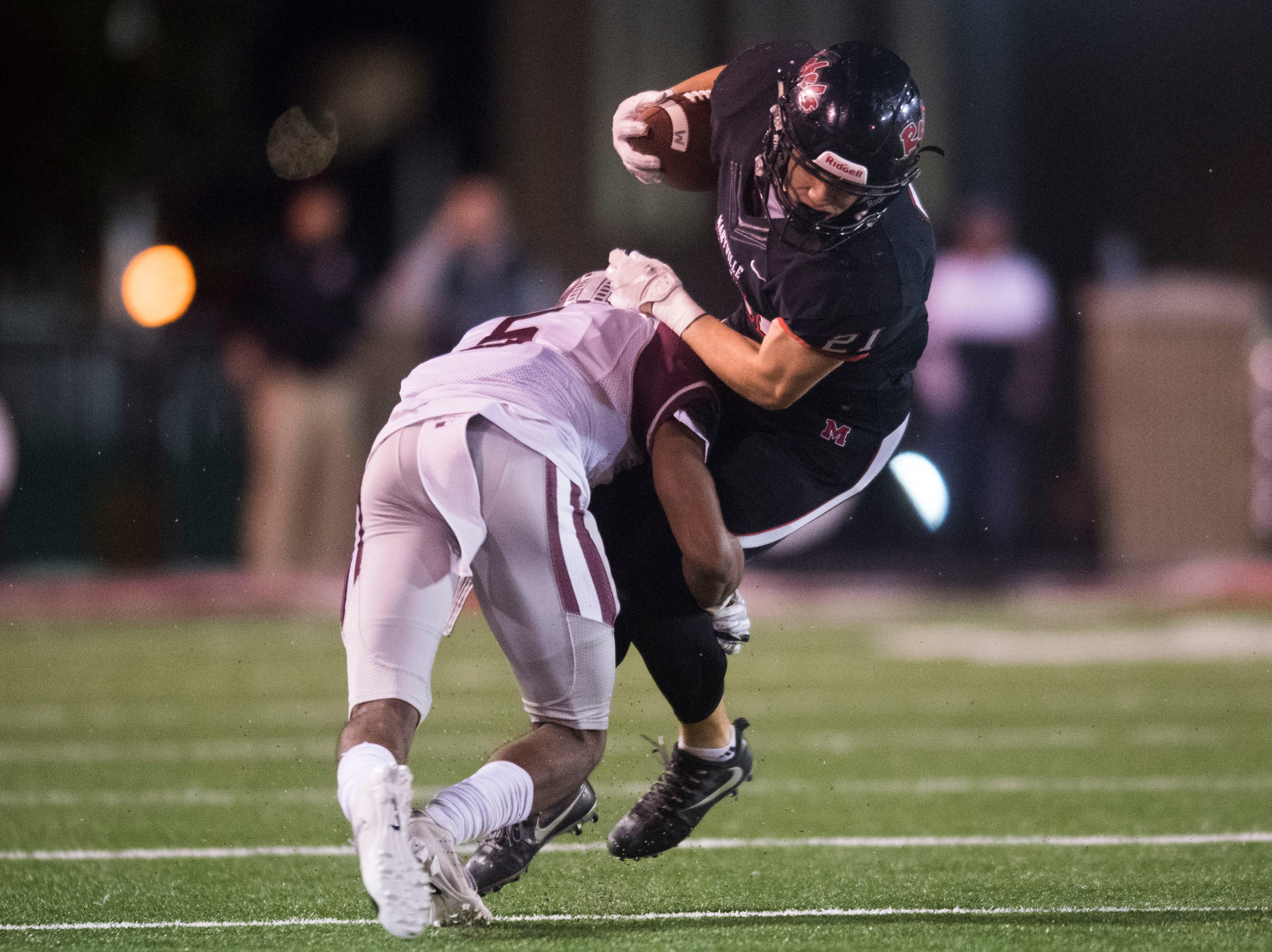 Maryville's Bryson Teffeteller (21) is tackled by Bearden's Kahlil Abdullah (5) during a first round playoff game between Maryville and Bearden at Maryville, Friday, Nov. 2, 2018. Maryville defeated Bearden 28-7.