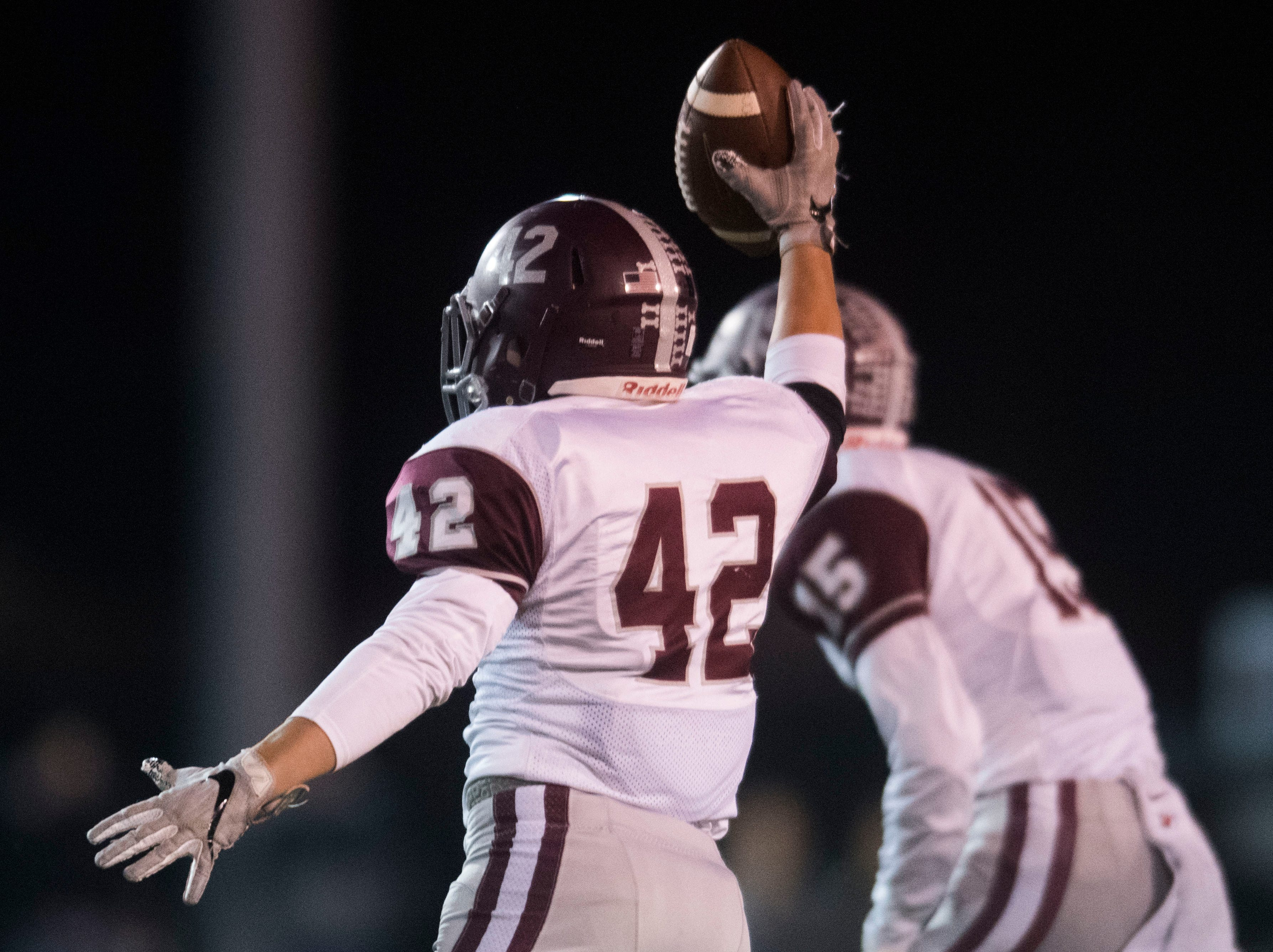Bearden's Ty Seritt (42) holds the ball in the air after a turnover during a first round playoff game between Maryville and Bearden at Maryville, Friday, Nov. 2, 2018. Maryville defeated Bearden 28-7.