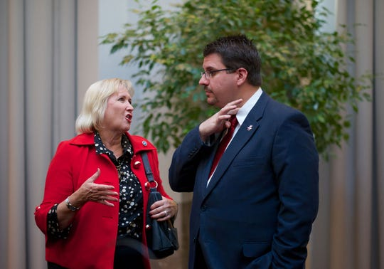 Sen. Becky Duncan Massey speaks with state Rep. Eddie Smith on Oct. 6, 2016, in Knoxville. Duncan Massey, R-Knoxville, is seeking the chairmanship of the Senate's Republican caucus.