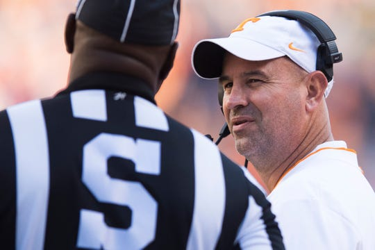 Tennessee Head Coach Jeremy Pruitt disputes a call with the referee during Tennessee's homecoming game against Charlotte at Neyland Stadium in Knoxville, Tennessee on Saturday, November 3, 2018.
