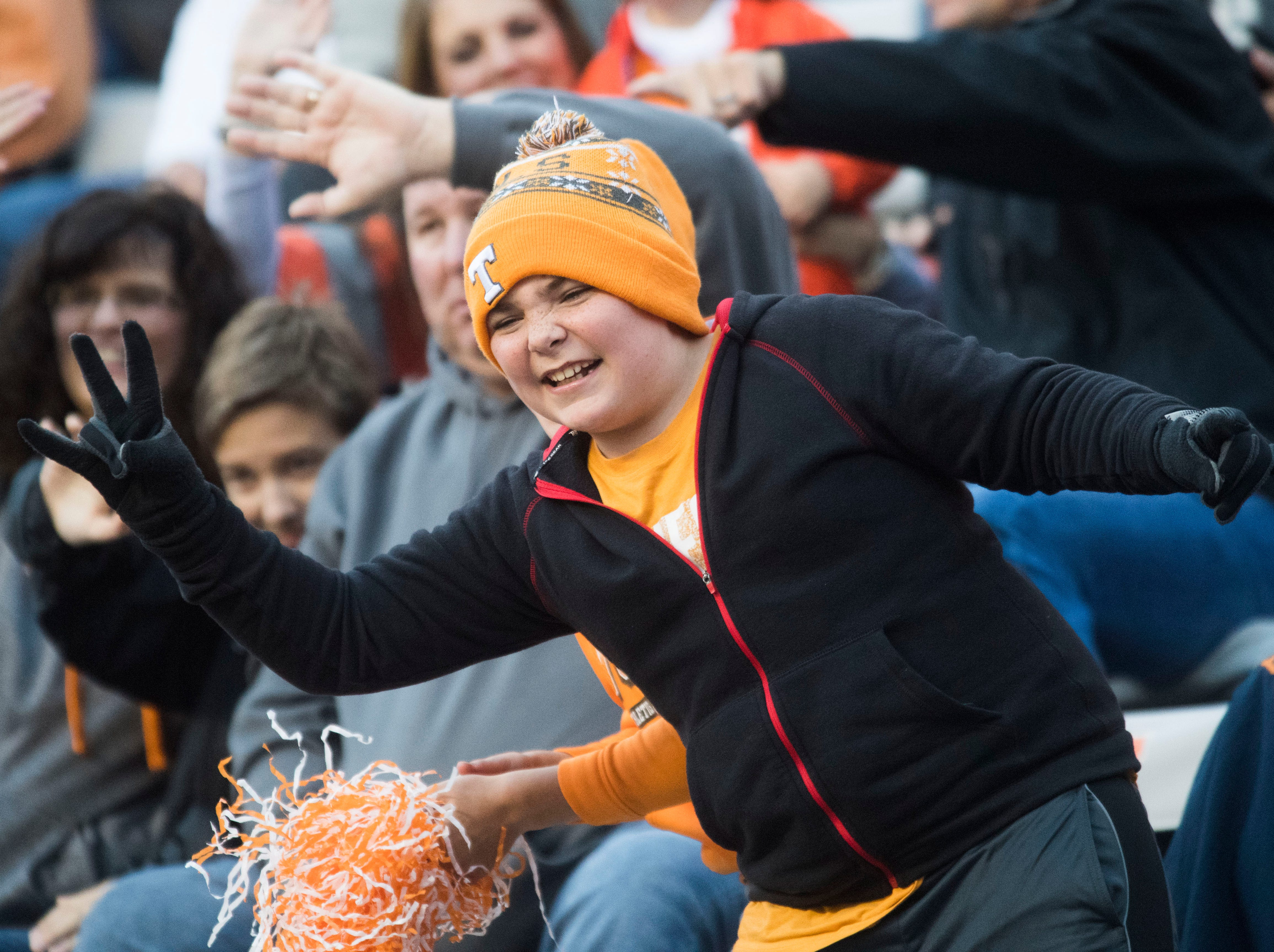 A young Tennessee fan celebrates during the homecoming game between Tennessee and Charlotte outside of Neyland Stadium Saturday, Nov. 3, 2018.
