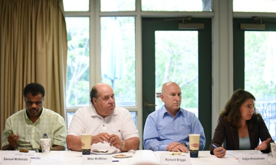 Members of the Knox County commission and school board, left to right, Samuel McKenzie, Mike McMillan, Richard Briggs and Indya Kincannon, met at the Ijams Nature Center for a public discussion of the $2.9 million deficit in the proposed budget, Tuesday, May 20, 2014.