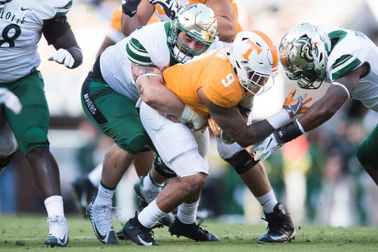 Tennessee running back Tim Jordan (9) is tackled by the defense during Tennessee's homecoming game against Charlotte at Neyland Stadium in Knoxville, Tennessee on Saturday, November 3, 2018.