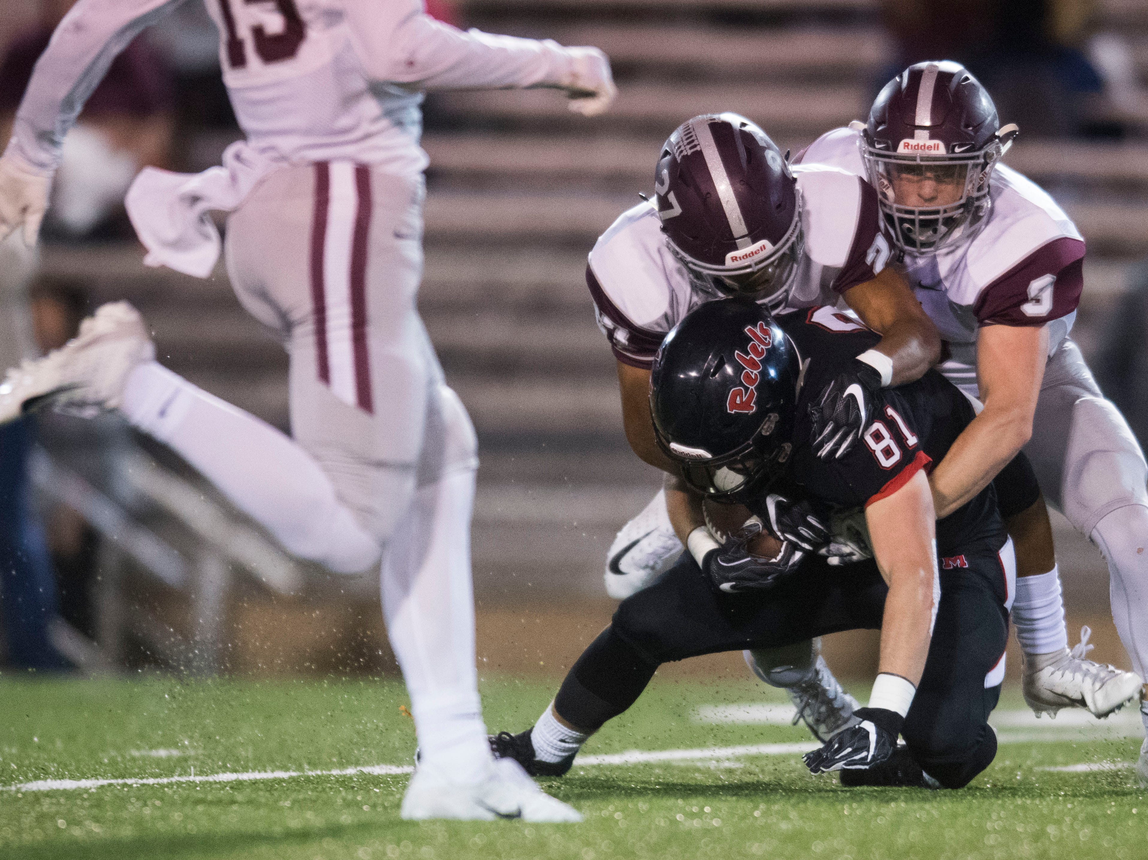 Bearden's Julian Kendrick (27) tackles Maryville's Brody Sloan (81) during a first round playoff game between Maryville and Bearden at Maryville, Friday, Nov. 2, 2018. Maryville defeated Bearden 28-7.
