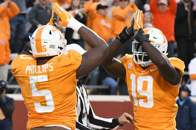 Tennessee defensive lineman Kyle Phillips (5) and Tennessee linebacker Darrell Taylor (19) celebrate what they thought was a safety during the homecoming game between Tennessee and Charlotte outside of Neyland Stadium Saturday, Nov. 3, 2018.