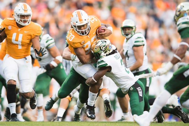 Tennessee running back Jeremy Banks (33) runs the ball during the homecoming game between Tennessee and Charlotte outside of Neyland Stadium Saturday, Nov. 3, 2018.