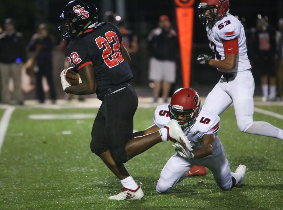 Central's Devone Moss (22) escapes Cocke County's Conner Ramsey (5) during the Central versus Cocke County high school football game at Central high school in Knoxville Friday Nov. 2, 2018.