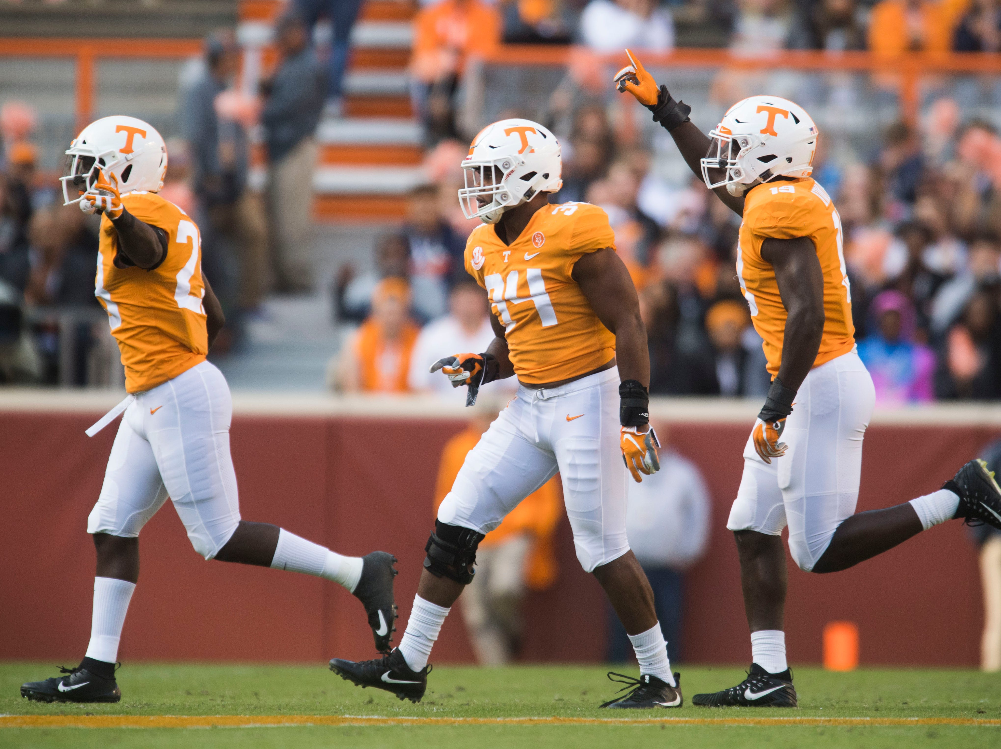 At center Tennessee linebacker Darrin Kirkland Jr. (34) runs off the field while celebrating during the homecoming game between Tennessee and Charlotte outside of Neyland Stadium Saturday, Nov. 3, 2018.