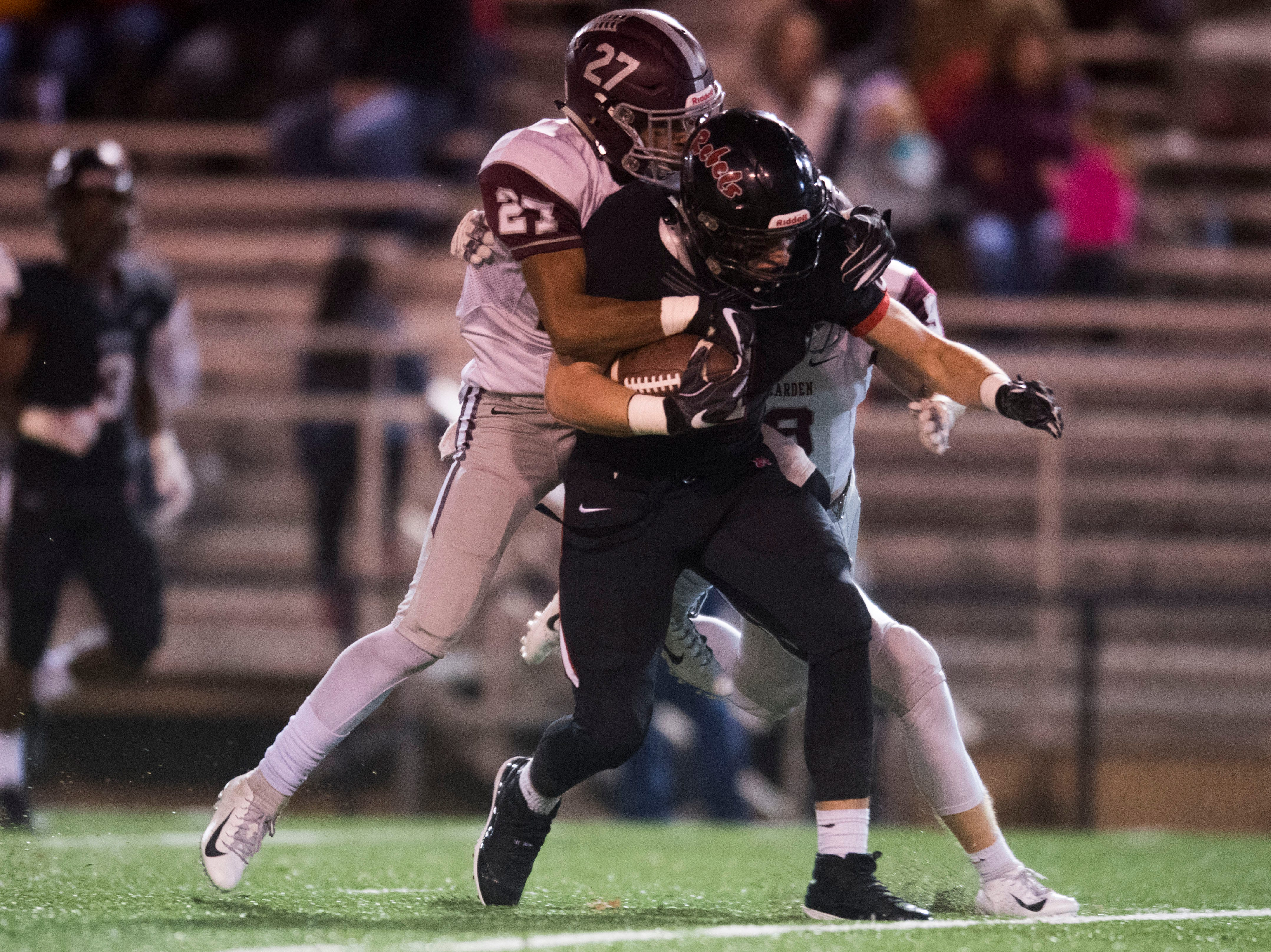 Bearden's Julian Kendrick (27) tackles a Maryville player during a first round playoff game between Maryville and Bearden at Maryville, Friday, Nov. 2, 2018. Maryville defeated Bearden 28-7.