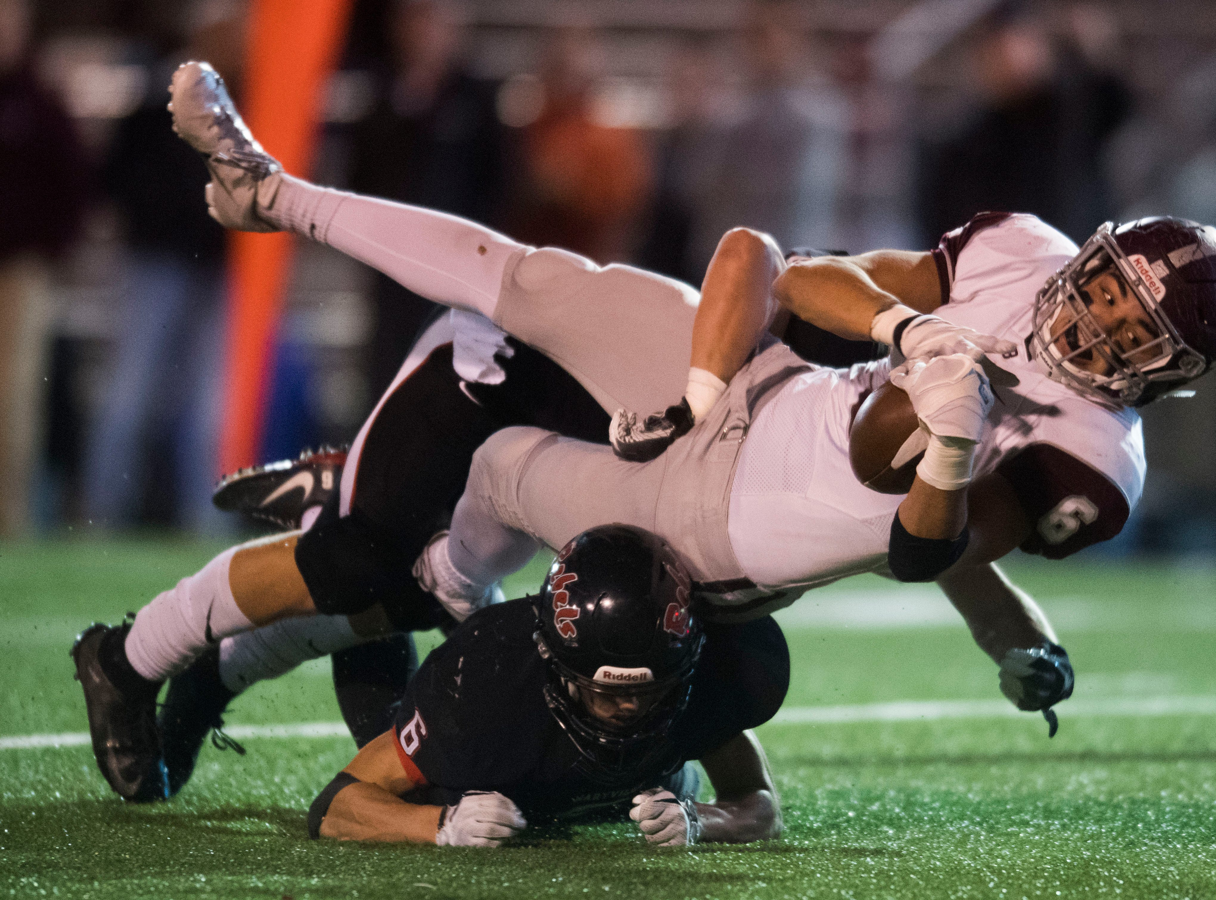 Bearden's Addison Ironside (6) is tripped up by Maryville's Michael Jones (6) during a first round playoff game between Maryville and Bearden at Maryville, Friday, Nov. 2, 2018. Maryville defeated Bearden 28-7.