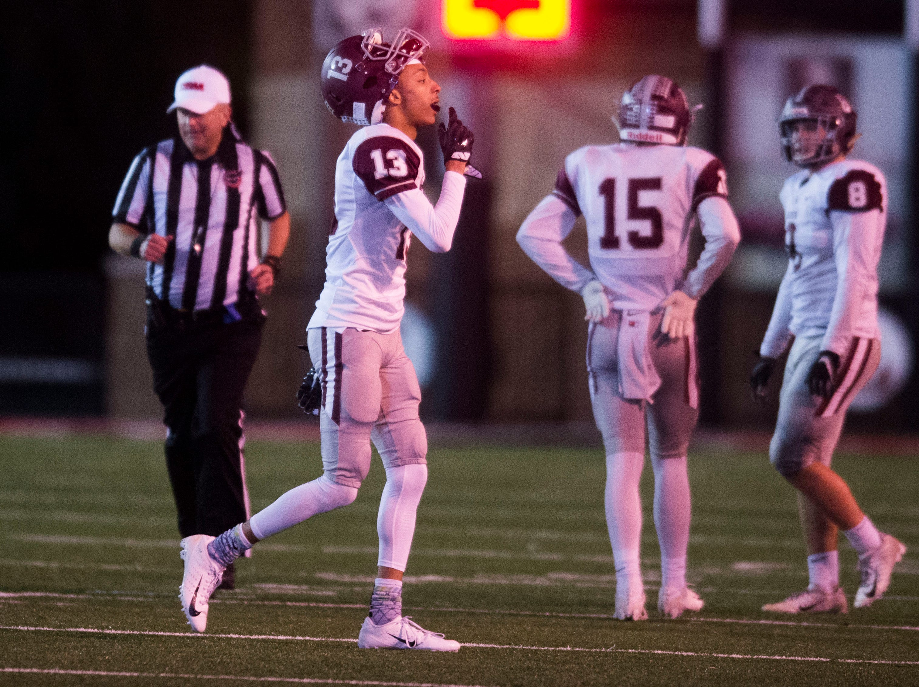 Bearden's Roman Robinson (13) walks off the field after a turnover during a first round playoff game between Maryville and Bearden at Maryville, Friday, Nov. 2, 2018. Maryville defeated Bearden 28-7.
