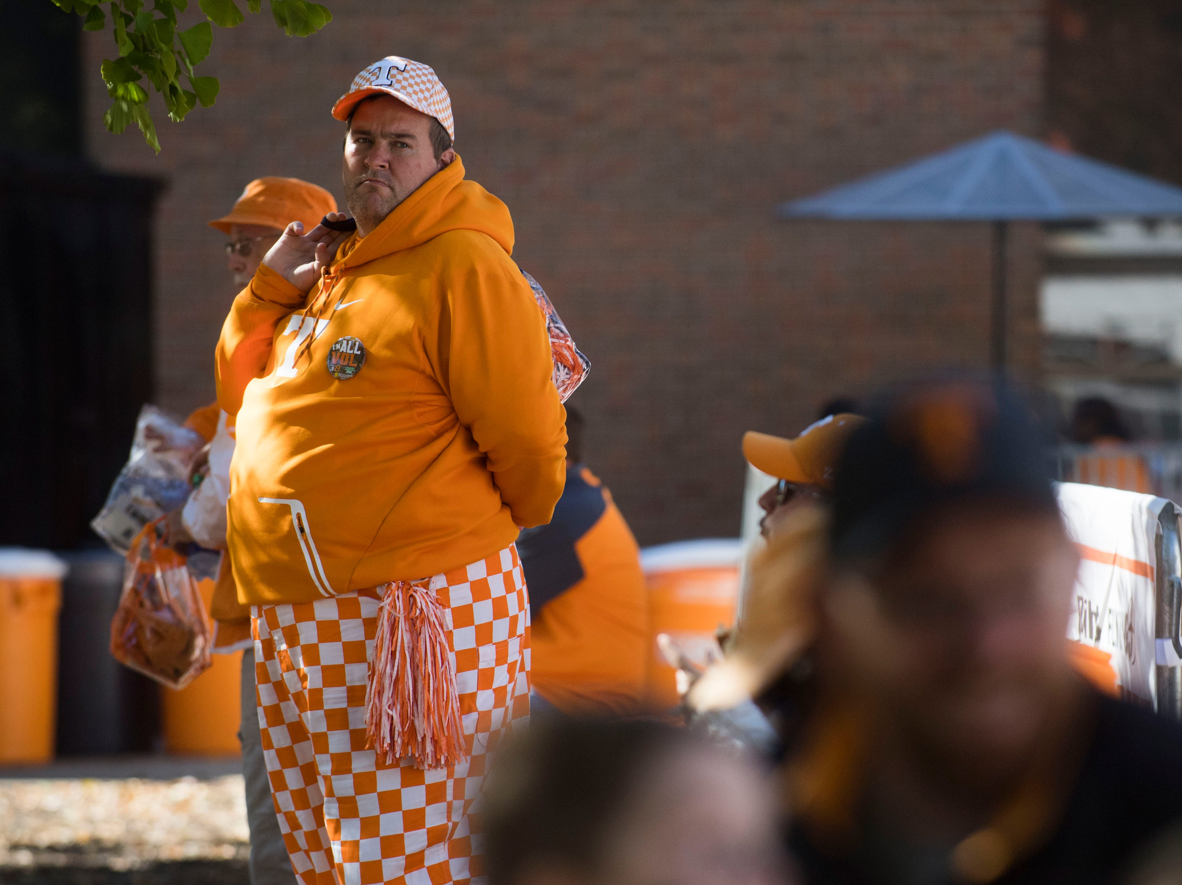 A Tennessee fan waits before the homecoming game between Tennessee and Charlotte outside of Neyland Stadium Saturday, Nov. 3, 2018.