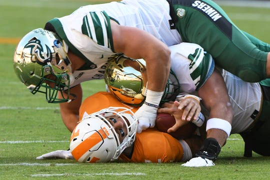 Charlotte players take down Tennessee quarterback Jarrett Guarantano (2) during the homecoming game between Tennessee and Charlotte outside of Neyland Stadium Saturday, Nov. 3, 2018.