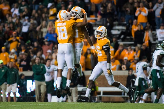 Tennessee defensive back Bryce Thompson (20) is congratulated by Tennessee defensive back Nigel Warrior (18) after making an interception during Tennessee's homecoming game against Charlotte at Neyland Stadium in Knoxville, Tennessee on Saturday, November 3, 2018.