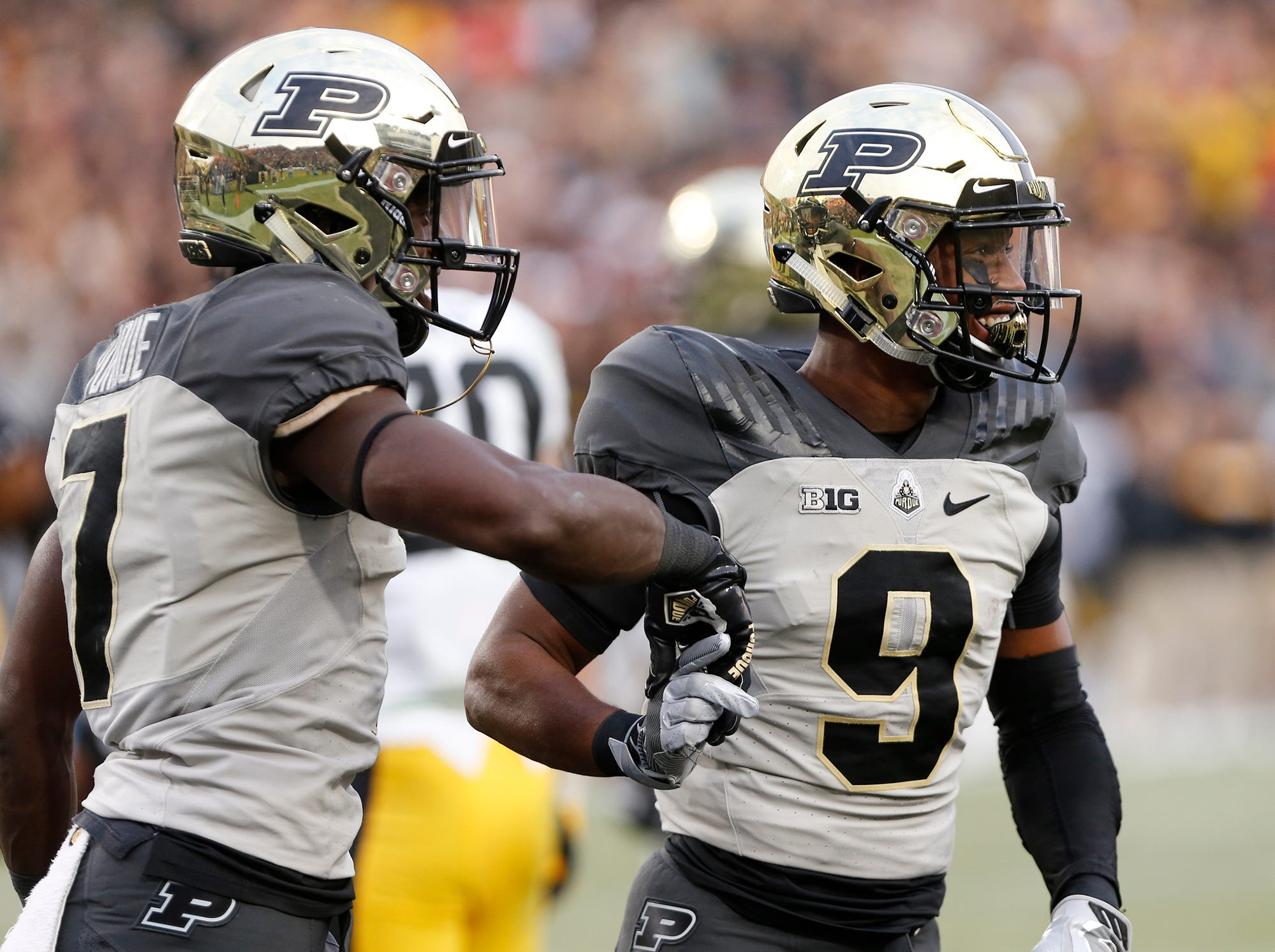 Terry Wright, right, of Purdue celebrates with teammate Isaac Zico after his touchdown reception at 2:26 in the third quarter against Iowa Saturday, November 3, 2018, at Ross-Ade Stadium. Purdue defeated Iowa 38-36.