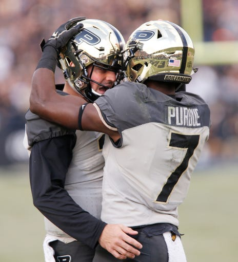 Purdue quarterback David Blough congratulates Isaac Zico after the pair connected for a touchdown at 11:56 in the first quarter against Iowa Saturday, November 3, 2018, at Ross-Ade Stadium.
