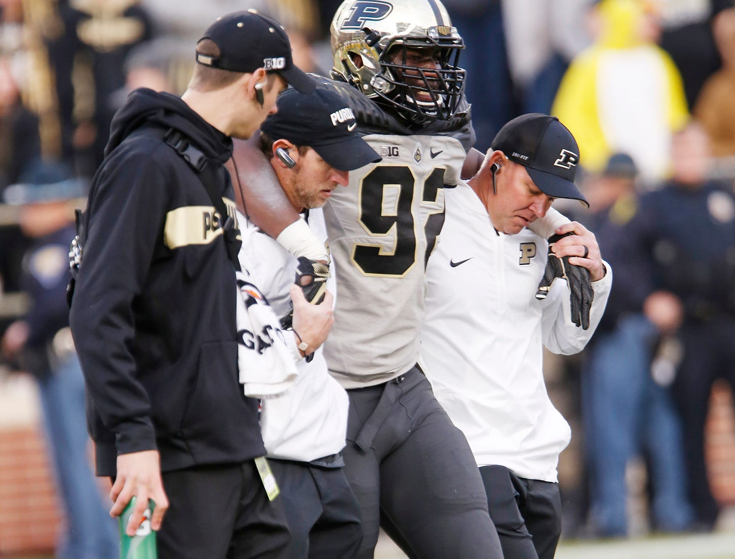 Giovanni Reviere of Purdue is helped off the field after suffering an injury in the second half against Iowa Saturday, November 3, 2018, at Ross-Ade Stadium. Purdue defeated Iowa 38-36.